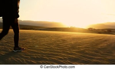 woman walking on a sand dune in the death valley