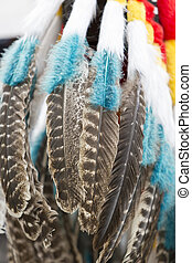 Background of colored hanging feathers in Andean craft market