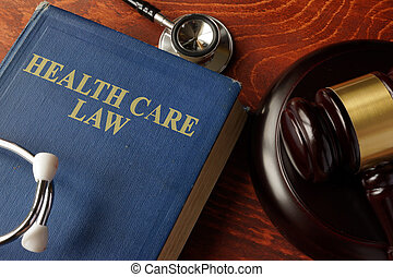 Book with title Health Care Law on a table.