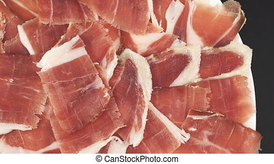 Acorn ham plate rotating closeup, top view - Top view of...