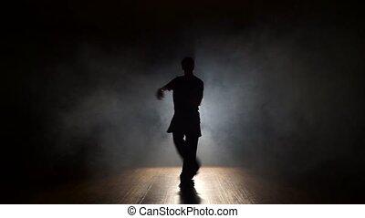 Dancing trendy dancing in smoke
