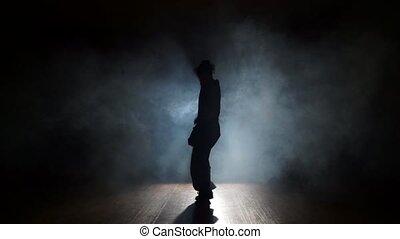 Man dancing trendy dancing in smoke
