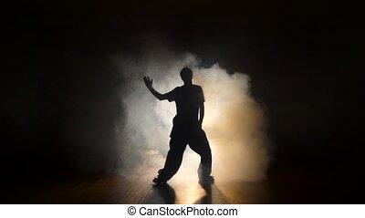 Dancer in the smoke in the dark.