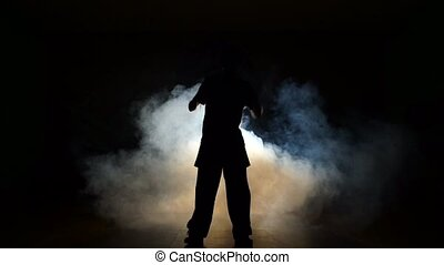 Dancer in a smoke on a black background