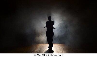 Man dancing in the dark.