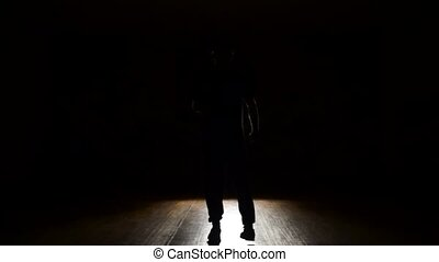 Man dancing in backlit