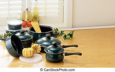 green pots and pans with copy space