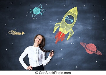 Start up concept - Thoughtful caucasian girl on chalkboard...