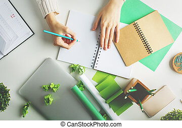 Woman writing in spiral notepad top - Woman with various...