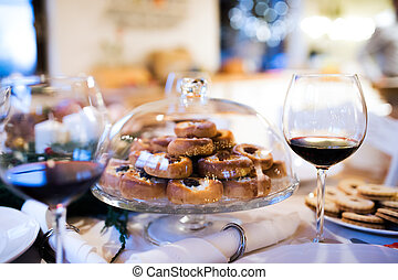 Christmas meal on a table. Pastry and red wine. - Christmas...