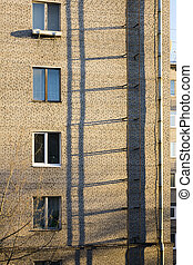 Fire escape on a wall of the brick multi storey building