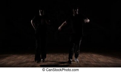 Two Boys dancing in the dark.