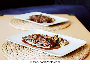 Venison with wine rose sauce and mushrooms