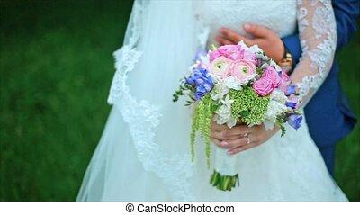 Grooms Hands on Waist of Beautiful Bride