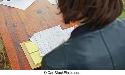 Woman Write Poem Note Paper Note on Wooden Table