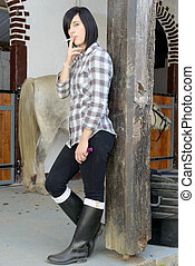 brunette girl dressed in horse riding clothes - beautiful...