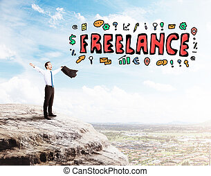 Freelance concept - Young businessman celebrating success on...