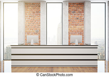 Red brick reception with computer monitors, wooden floor and...