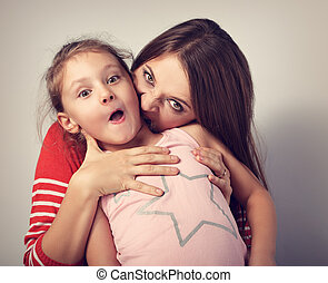 Angry emotional young mother wanting to bite her naughty capricious daughte