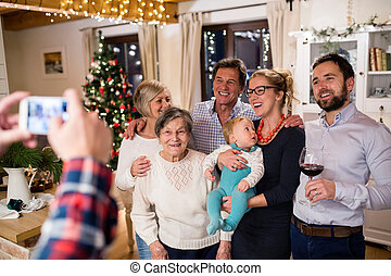 Beautiful big family celebrating Christmat together being...
