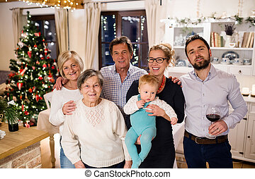 Beautiful big family celebrating Christmat together at home....