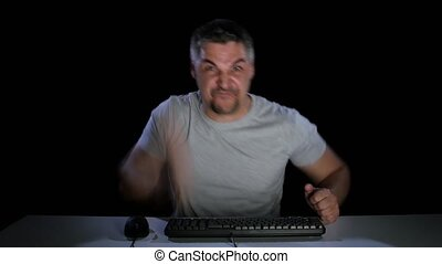 Man in a anger shows someone in a computer monitor - Man in...