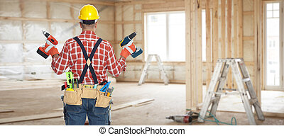 Electrician with drill. - Builder handyman with construction...