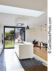 Open modern kitchen from loft with view on a lush garden