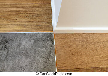 Joints between wood, baseboards and stone floor - Close up...