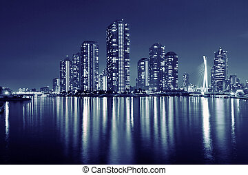 night city - split toned image of Tokyo skyline in modern...