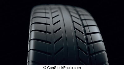 Close up on a car tire in motion, with deph of field effect. Seamless looping animation, 4k animation.
