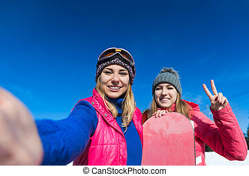 Two Woman Ski And Snowboard Resort Winter Snow Mountain...