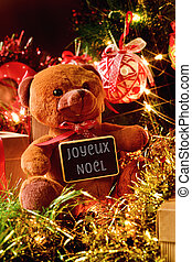text joyeux noel, merry christmas in french - closeup of a...