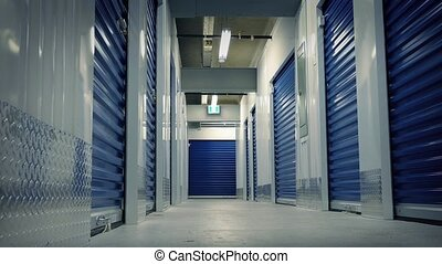 Moving Past Storage Lockers - Sideways tracking shot moving...