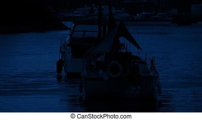 Boats In The Harbor At Night - Boats floating in the harbor...