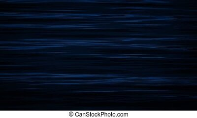 Rippling Water Surface At Night - Calm water surface ripples...