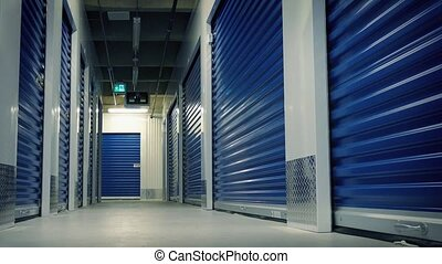 Moving Past Lockers In Storage Facility - Dolly shot moving...