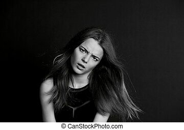 young girl with long hair. Daring look in . BW - A young...