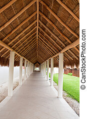 Long Walkway Under Straw Thatched Roof - A long walkway...