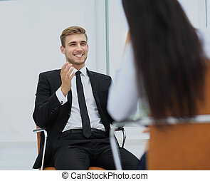 Young manager listening to his colleague explanations -...