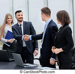shaking hands in the office at the beginning of the working day