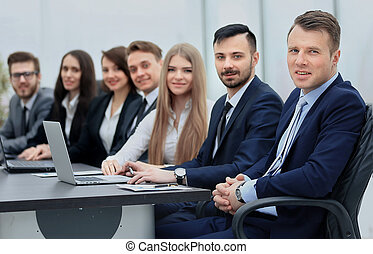 Business team in a line smiling at the camera