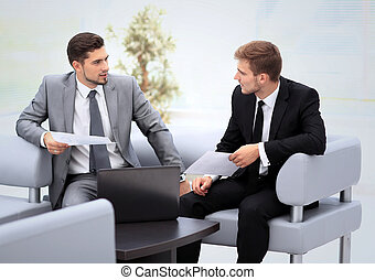 Business people Having Meeting Around Table In Modern Office...