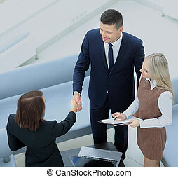 Businesswoman shaking hands to seal a deal with her partner...