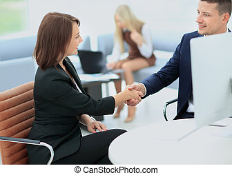 Two successful business people - Business people shaking...