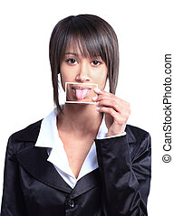Girl holding a card with photo her tongue in front of her mouth