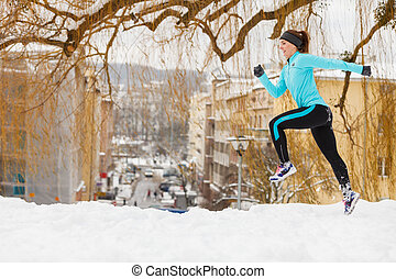 Winter sports, girl exercising in city - Girl exercising on...