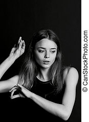 Young beautiful girl with long hair. Moving in a dance, hand...