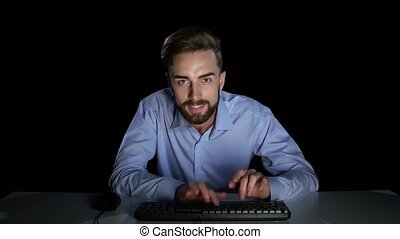 Man with a excitedly rewritten in online chat. Dark studio -...