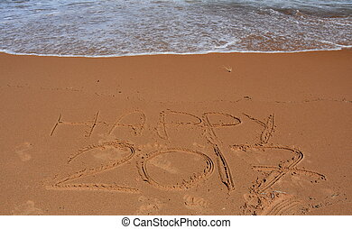 "Happy 2017 written on sand at sunset. Happy 2017 lettering on the beach. ""Happy 2017"" drawn on sand on a beach, closeup shot. Happy 2017  written in sand, on tropical beach."